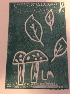 Illustration: Falling autumn leaves and fungi by Lowenna Mitchell aged 6 years (lino print based on outdoor observations)